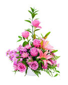 Colorful purple flower arrangement centerpiece with roses, lily, carnations, isolated on white. — Stock Photo