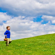 Easter egg hunt with young boy running with basket to collect Easter Eggs — Stock Photo