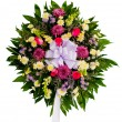 Colorful flower arrangement wreath for funerals isolated on white — Stock Photo #9937318