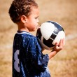 Young African-American boy with soccer ball before game — Stock Photo