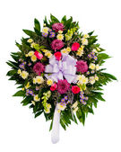 Colorful flower arrangement wreath for funerals isolated on white — Stock Photo