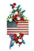 Colorful funeral flower arrangement with patriotic design. — Stock Photo