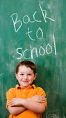 Back to school education concept with child in front of chalkboard — Stock Photo