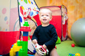Baby boy playing in nursery — Stock Photo