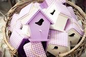 Basket full of bird houses — Stock Photo