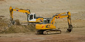 Excavators in action — Stock Photo