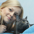 Female with grey cat — Stock Photo