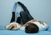 Boy and girl connecting legs on the wall — Stock Photo