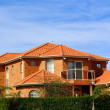 House with terracotta roof tiles - Stock fotografie