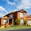 New home in a subdivision - Stock Photo