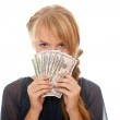 Young woman holding money in the face — Stock Photo