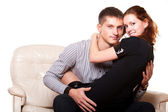 Young woman sitting on lap man — Stock Photo