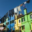 Colorful houses in Burano street, Italy - Stock Photo