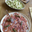 Healthy bean salad and cutting sausage and cured meat — Stock Photo #9210643