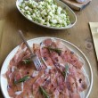 Healthy bean salad and cutting sausage and cured meat — Stock Photo