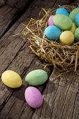 Colored chocolate eggs — Stock Photo