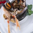 Seafood soup with squid — Stock Photo