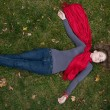 Brunette beautiful woman is in red scarf lying on the grass. — Stock Photo #8831854