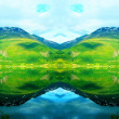 Reflection of the mountains and the sky in the water — Stock Photo
