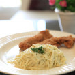 Spaghetti Carbonara with fried chicken — Stock Photo