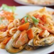 Seafood pasta with tomato sauce — Stock Photo #10245446