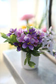 Purple flower in jar — Stock Photo