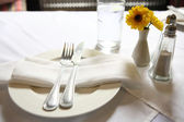 Table set with flower — Stock Photo