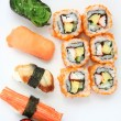 Foto de Stock  : Mix sushi isolated in white background