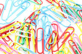 Isolated colorful paper clips background — Stock Photo