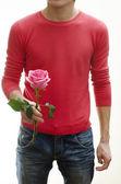Een man bedrijf bloem — Stockfoto