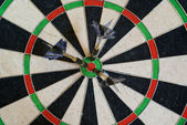 Three darts in the center of the target — Stock Photo