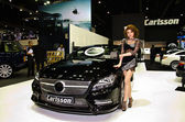 Pretty girl with Carlsson car — Stock Photo