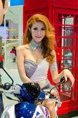 Pretty girl with Honda motorcycle — Stock Photo