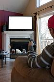 Man Watches TV — Stock Photo
