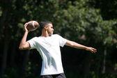 Man Throwing a Football — Stock Photo