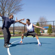 Stock Photo: Men Playing Basketball