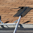 Damaged Roof Shingles Repair - Stock Photo