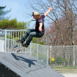 Stock Photo: Skateboarder On a Skate Ramp