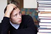Stressed Student Looks At Books — Stock Photo