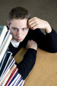 Overloaded Student Looking At Pile of Books — Stock Photo
