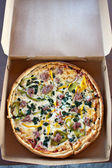 Takeout Specialty Combination Pizza — Stock Photo