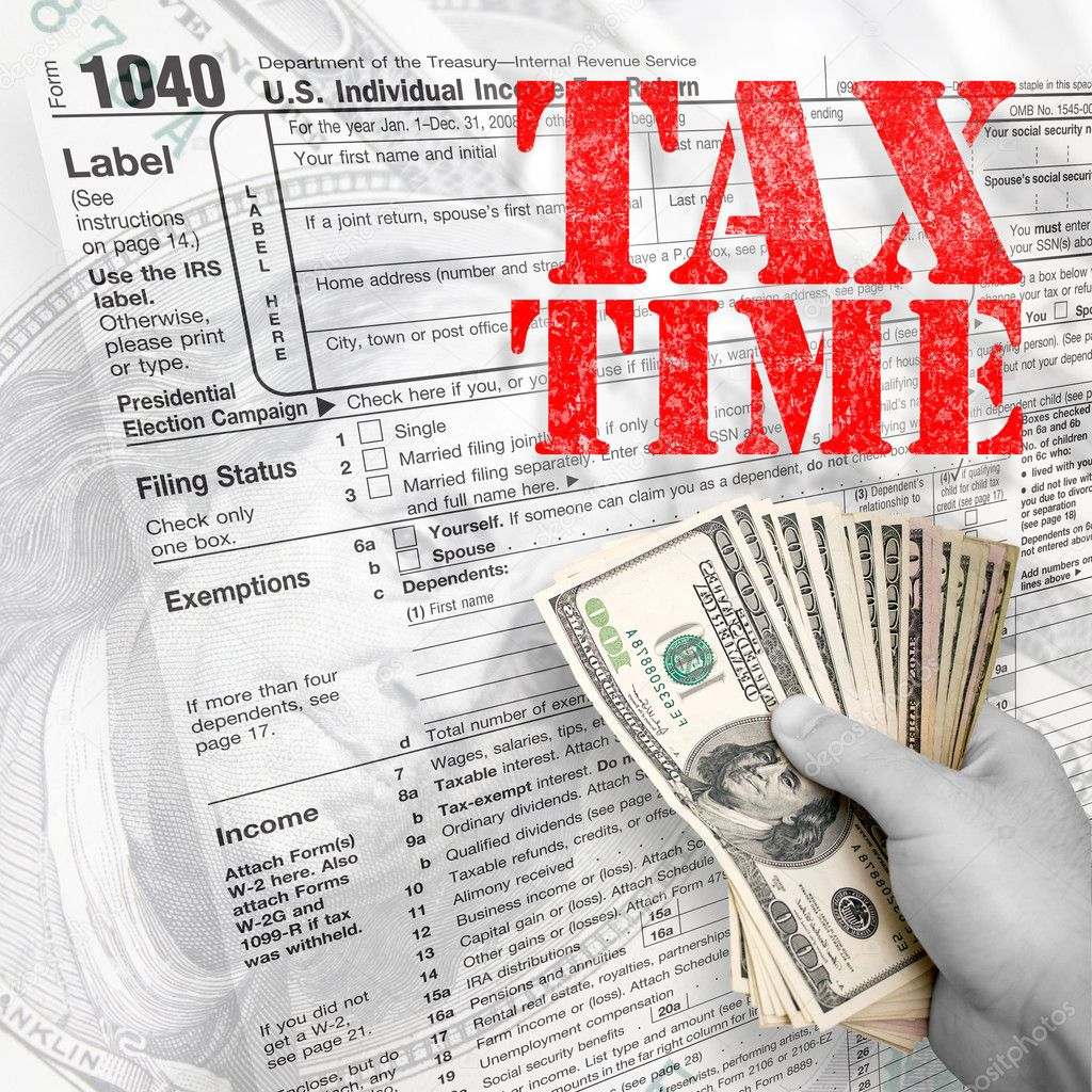 A tax time themed montage for US taxpayers with a hand full of money fanned out.  Stock Photo #8694086