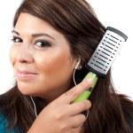 Woman Brushing Her Hair — Stock Photo #8784578