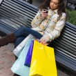 Shopper With Mobile Phone — Stock Photo