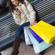Shopper With Mobile Phone — Stock Photo #8788927