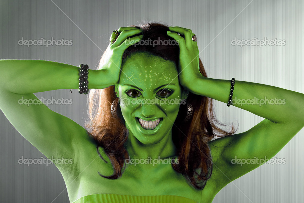 A green alien or Martian woman posing over a silver brushed metal backdrop. — Stock Photo #8781381