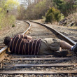 Stock Photo: Laying on Rails