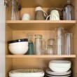 Dishes in the Cupboard — Stock Photo