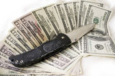 Dirty Cash and Knife — Stock Photo