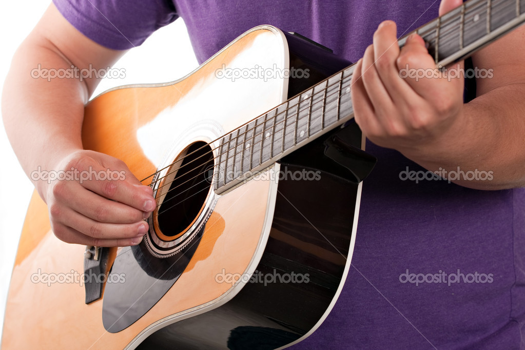 Closeup of a mans hands strumming and electric acoustic guitar isolated over a white background. — Stock Photo #8803719